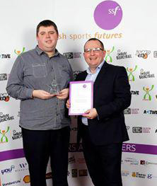Paul Rankin from Luma IT presents David with his award.